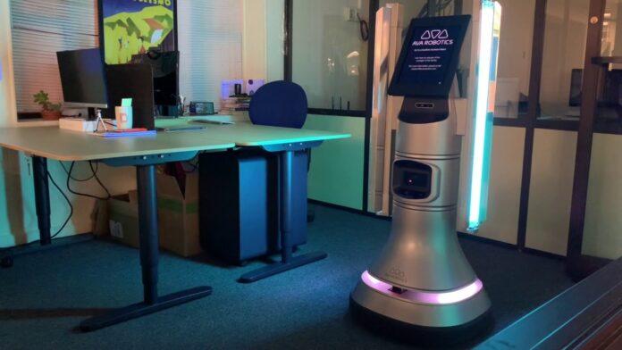 A UV disinfection robot from Ava Robotics next to an empty desk