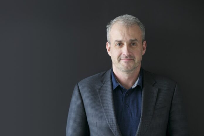 Picture of Joe Petro, CTO of Nuance, against a black background