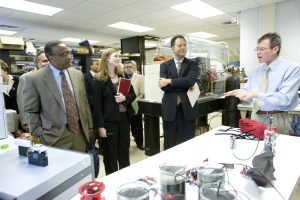 People in suits in a lab