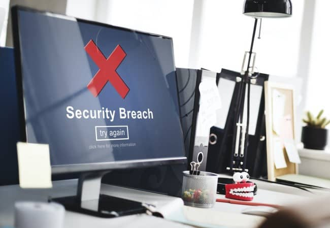 Computer with security breach on screen