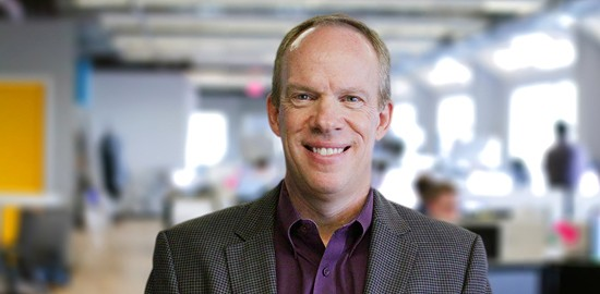Headshot of Fuze CEO Brian Day in offices