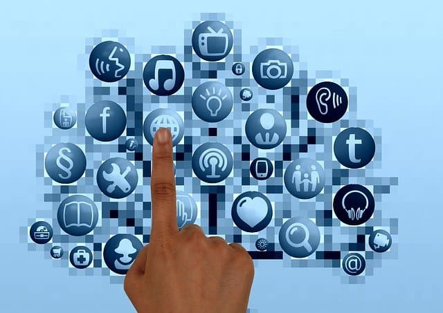 social media icons with a finger touching one