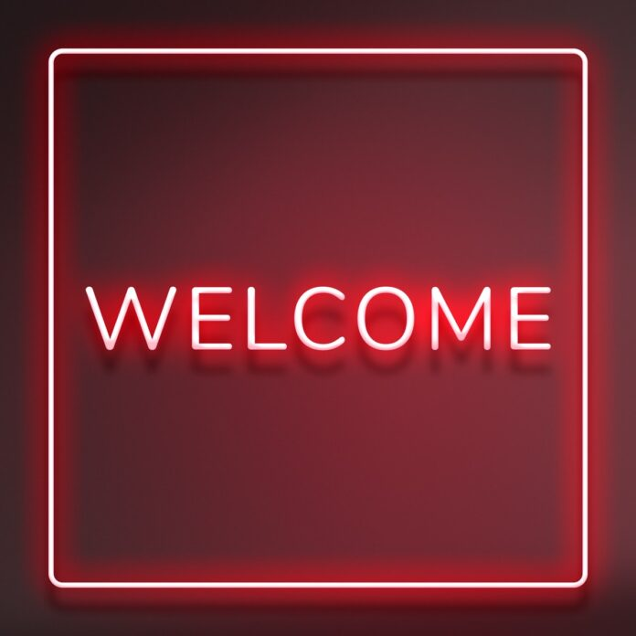 Image of neon Welcome sign