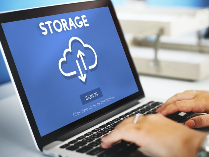 Image of a computer showing cloud storage on a blue screen