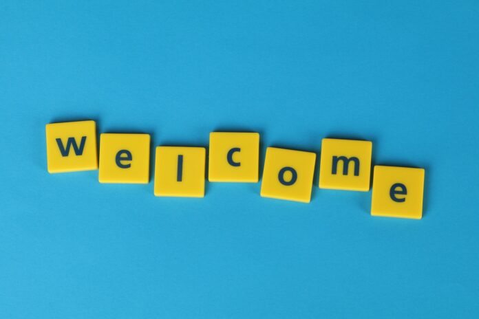 Image of Welcome tiles on a blue background