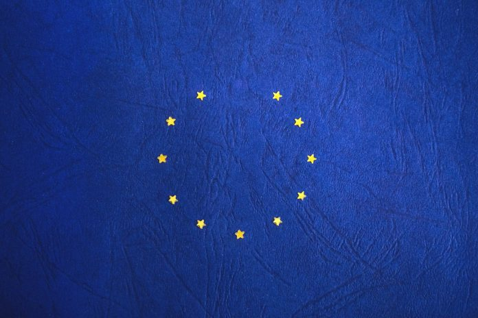 A blue backdrop with yellows arranged in a circle, just like the EU flag