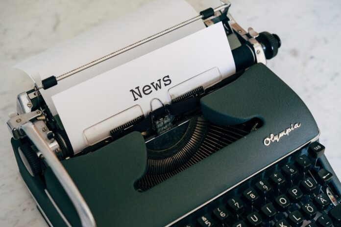 Typewriter with the word
