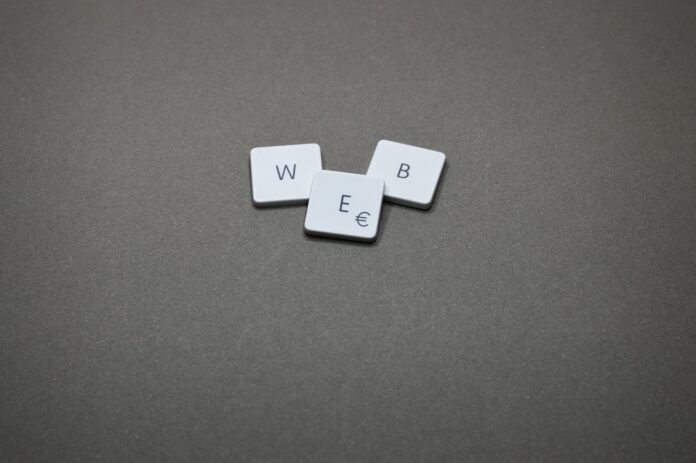 Scrabble-style tiles arranged to spell out W-E-B