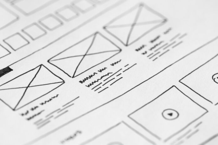 Up close view of a white piece of paper with a mockup of a website wireframe design