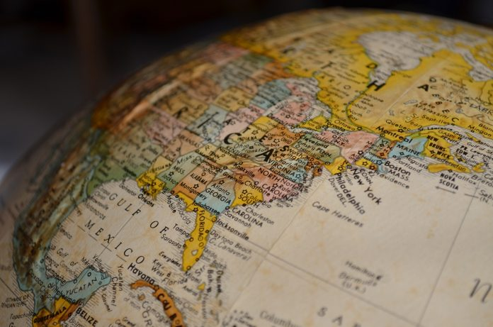 An extremely close up shot of a globe. The east of North America is visible.