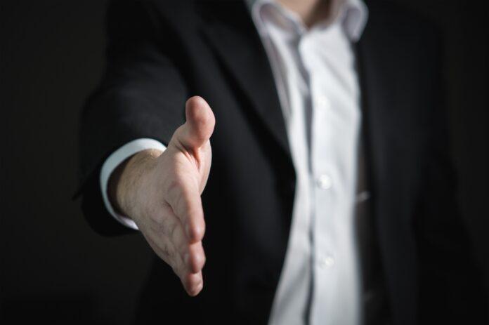 man exteding his hand to shake