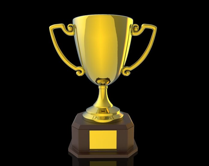Gold trophy cup on a black background