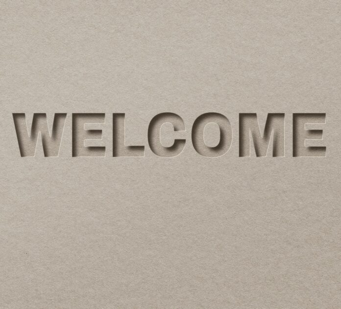 Image of Welcome on a cardboard background